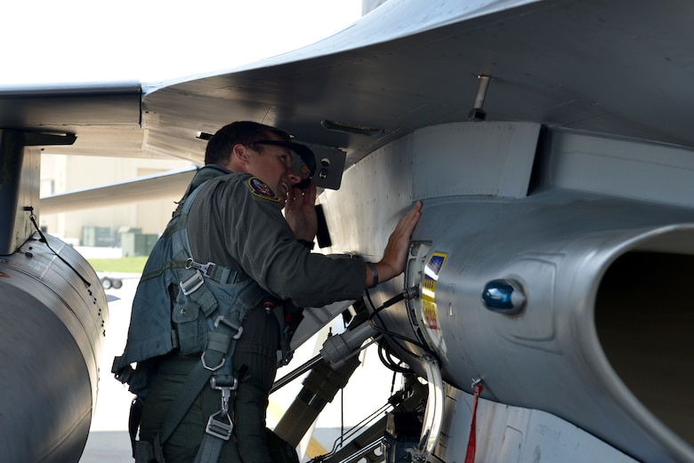 U.S. Air Force Capt. Matthew Kimmel, 79th Fighter Squadron (FS) pilot and U.S. Thunderbirds pilot-select, inspects an F-16CM Fighting Falcon prior to flying at Shaw Air Force Base, S.C., July 19, 2016. Kimmel was inspired by the Thunderbirds when he watched them perform at a Travis Air Force Base Air Show in California. (U.S. Air Force photo by Airman 1st Class Destinee Sweeney)