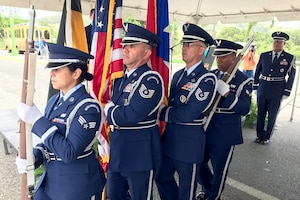 U.S. Airmen of the 156th Airlift Wing honor guard detail render military honors during Brig. Gen. Mihiel Gilormini's posthumous street naming ceremony held in Yauco, Puerto Rico, July 15. (U.S. Air National Guard photo by Staff Sgt. Mizraim Gonzalez/Released)