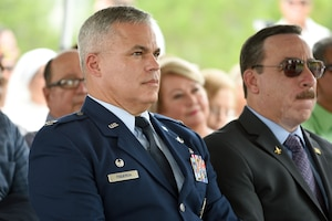 U.S. Air Force Col. Raymond Figueroa, 156th Airlift Wing commander, and retired Col. Carlos Quiñones participate in Brig. Gen. Mihiel Gilormini's posthumous street naming ceremony held in Yauco, Puerto Rico, July 15.