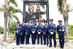U.S. Airmen of the Puerto Rico Air National Guard pose before Brig. Gen. Mihiel Gilormini's memorial along with his children during Brig. Gen. Mihiel Gilormini's posthumous street naming ceremony held in Yauco, Puerto Rico, July 15. (U.S. Air National Guard photo by Staff Sgt. Mizraim Gonzalez/Released)