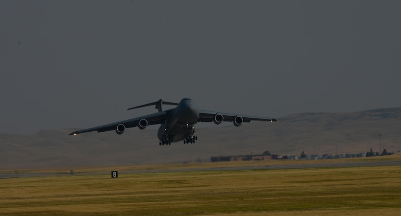 A C-5M Super Galaxy assigned to the 22nd Airlift Squadron, Travis Air Force Base, Calif., takes off from Ellsworth Air Force Base, S.D., July 22, 2017. The C-5 transported equipment and personnel in support of the Continuous Bomber Presence missions in the Pacific theater. (U.S. Air Force photo by Airman Nicolas Z. Erwin)