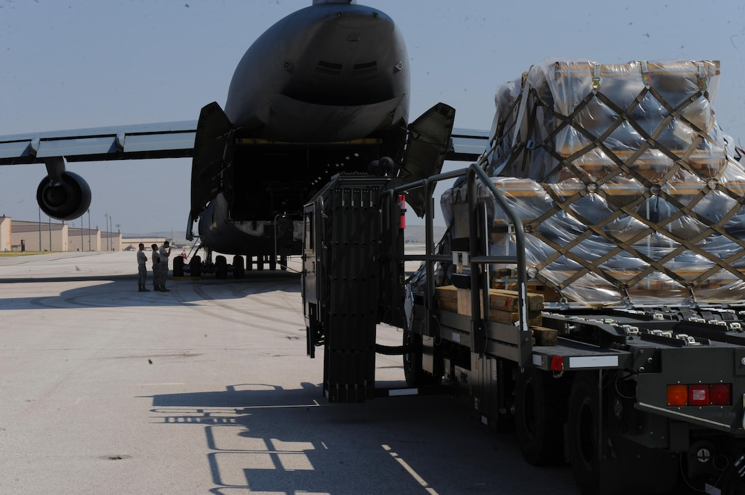 Airmen assigned to the 22nd Airlift Squadron, Travis Air Force Base, Calif., load cargo onto a C-5M Super Galaxy at Ellsworth Air Force Base, S.D., July 22, 2017. More than 350 Airmen deployed to Andersen Air Force Base, Guam, in support of the Continuous Bomber Presence mission in the Pacific. (U.S. Air Force photo by Airman Nicolas Z. Erwin)