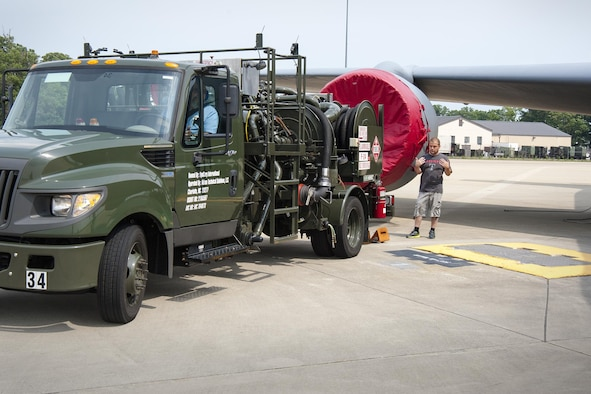 Tech. Sgt. Thomas Conroy, 459th Aircraft Maintenance Squadron crew chief, guides a fuel truck into place prior to refueling a KC-135R Stratotanker on the Joint Base Andrews, Maryland, flight line July 20, 2017. The truck contains a hydraulic system used to draw fuel from underground reservoirs into the aircraft. (U.S Air Force photo/Tech. Sgt. Kat Justen)