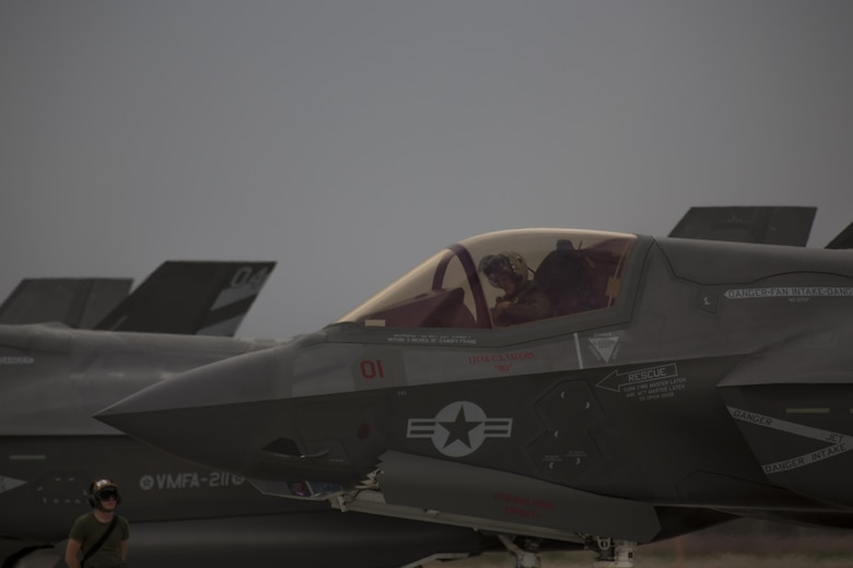 """A pilot with Marine Fighter Attack Squadron (VMFA) 211 """"Wake Island Avengers,"""" 3rd Marine Aircraft Wing, prepares to exit an F-35B Lightning II after landing at Nellis Air Force Base, Nev., July 10. A total of 10 F-35B Lightning IIs and 250 Marines with VMFA-211 participated in Red Flag 17-3, a realistic combat training exercise hosted by the U.S. Air Force, to assess the squadron's ability to deploy and support contingency operations using the F-35B. (U.S. Marine Corps photo by Sgt. Lillian Stephens/Released)"""