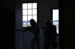 A team of 673d Security Forces Squadron members sweep a room during active-shooter training at Joint Base Elmendorf-Richardson, Alaska, July 18, 2017. Security forces trained in high-stress environments with hostages and aggressive perpetrators, so they learned how to appropriately respond and handle various hostile situations.