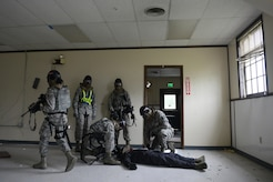 A team of 673d Security Forces Squadron members identify the condition of a simulated perpetrator during active-shooter training at Joint Base Elmendorf-Richardson, Alaska, July 18, 2017. Security forces trained in high-stress environments with hostages and aggressive perpetrators so they learned how to appropriately respond and handle various hostile situations. (U.S. Air Force photo by Airman 1st Class Christopher R. Morales)