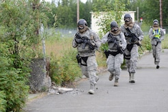 A team of 673d Security Forces Squadron members approach a building during active-shooter training at Joint Base Elmendorf-Richardson, Alaska, July 18, 2017. Security forces trained in high-stress environments with hostages and aggressive perpetrators so they learned how to appropriately respond and handle various hostile situations.