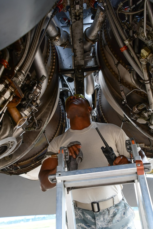 Master Sgt. Ron Harris, 307th Maintenance Squadron, checks for leaks on the engines of a B-52 Stratofortress prior to performing an engine run on Barksdale Air Force Base, La. June 29, 2017. All eight Pratt and Whitney turbofan engines are carefully inspected before the bomber is returned to service after a phase inspection. (U.S. Air Force photo by Master Sgt. Dachelle Melville/Released)