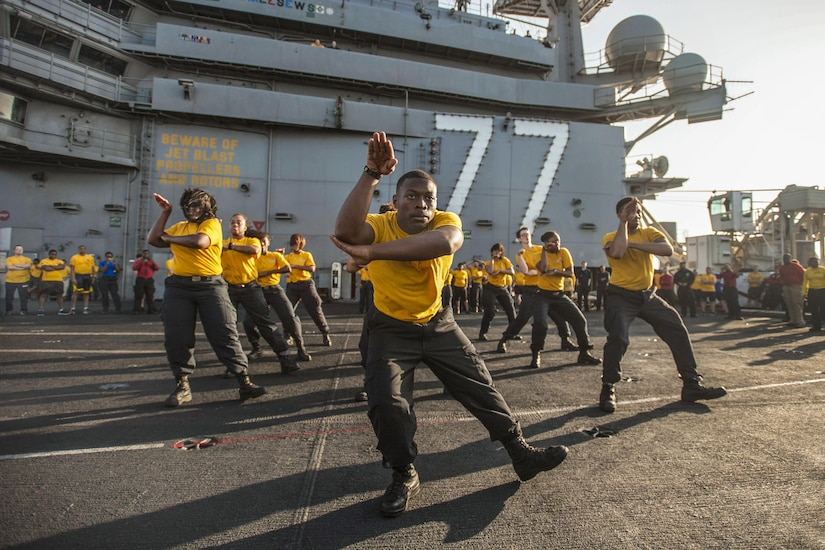 A step team performs before a suicide prevention and awareness 5K run aboard the aircraft carrier USS George H.W. Bush in the Mediterranean Sea, July 22, 2017. The ship and its carrier strike group are conducting naval operations in the U.S. 6th Fleet area of operations to support U.S. national security interests in Europe and Africa. Navy photo by Petty Officer 3rd Class Tristan B. Lotz