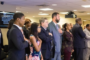 Federal employees and interns who earned the 2017 Workforce Recruitment Program Judith C. Gilliom awards stand for the National Anthem during the annual award and networking event at the U.S. Access Board in Washington, D.C., July 27, 2017. The U.S. Department of Labor's Office of Disability Employment Policy co-hosted the event. Department of Labor photo by Alyson Fligg
