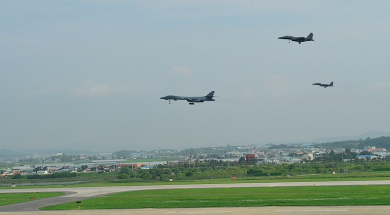 In a demonstration of ironclad U.S. commitment to our allies, two U.S. Air Force B-1B Lancers assigned to the 9th Expeditionary Bomb Squadron, deployed from Dyess Air Force Base, Texas, perform a low pass over Osan Air Base, Republic of Korea, during a 10-hour mission from Andersen Air Force Base, Guam, into Japanese airspace and over the Korean Peninsula, July 30, 2017. The B-1s first made contact with Japan Air Self-Defense Force F-2 fighter jets in Japanese airspace, then proceeded over the Korean Peninsula and were joined by South Korean F-15 fighter jets. This mission is in direct response to North Korea's escalatory launch of intercontinental ballistic missiles on July 3 and 28.  (U.S. Air Force photo/Tech. Sgt. Benjamin Wiseman)