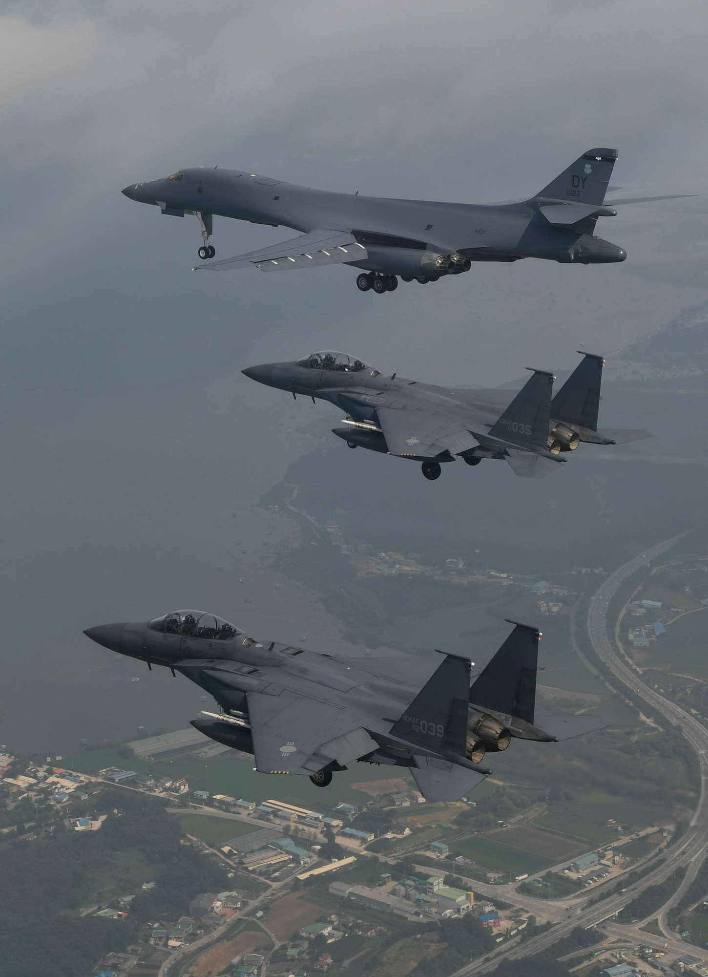 In a demonstration of ironclad U.S. commitment to our allies, a U.S. Air Force B-1B Lancer assigned to the 9th Expeditionary Bomb Squadron, deployed from Dyess Air Force Base, Texas, is joined by Republic of Korea air force F-15s during a 10-hour mission from Andersen Air Force Base, Guam, into Japanese airspace and over the Korean Peninsula, July 30, 2017. The B-1s first made contact with Japan Air Self-Defense Force F-2 fighter jets in Japanese airspace, then proceeded over the Korean Peninsula and were joined by South Korean F-15 fighter jets. This mission is in direct response to North Korea's escalatory launch of intercontinental ballistic missiles on July 3 and 28. (Courtesy photo)