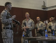 U.S. 5TH FLEET AREA OF OPERATIONS - U.S. Marine Corps Chief Warrant Officer 2 Mark Erhardt, Battalion Gunner with 1st Battalion, 7th Marine Regiment, Special Purpose Marine Air-Ground Task Force-Crisis Response-Central Command, discusses room clearing and close quarter combat tactics with Marines in Jordan, July 19, 2017. This training ensures SPMAGTF-CR-CC Marines sustain vital skills to enhance their ability to react to any mission they may encounter while conducting USCENTCOM's crisis response mission. (U.S. Marine Corps photo by Cpl. Kyle McNan)