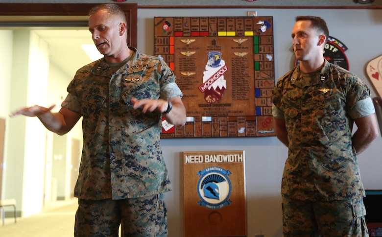 Maj. Gen. Matthew Glavy, talks to a crowd about Capt. Peter Abramovs during an awards ceremony aboard Marine Corps Air Station Cherry Point, N.C., July 28, 2017. Abramovs was awarded the Air Medal for heroism while training at Marine Corps Training Area Bellows, O'ahu, Hawai'i, on May 17, 2015. While conducting MV-22 Osprey training exercises, an aircraft conducted a hard landing at the training area, May 17, 2015. Although wounded during the hard landing, Abramovs returned to the downed aircraft multiple times in order to evacuate and aid his fellow Marines. Glavy is the commanding general of 2nd Marine Aircraft Wing, and Abramovs is an AV-8B Harrier II pilot with Marine Attack Squadron 231, Marine Aircraft Group 14, 2nd MAW. (U.S. Marine Corps Photo by Pfc. Skyler Pumphret/ Released)