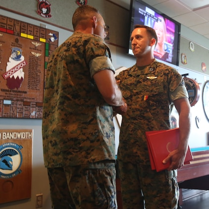 Maj. Gen. Matthew Glavy, shakes the hand of Capt. Peter Abramovs after awarding him the Air Medal at Marine Corps Air Station Cherry Point, N.C., July 28, 2017. Abramovs was awarded the Air Medal for rescuing multiple Marines when his MV-22 Osprey experienced a hard landing on May 17, 2015. Abramovs was injured in the landing, but charged into the burning wreckage to help his fellow Marines. Glavy is the commanding general of 2nd Marine Aircraft Wing, and Abramovs is an AV-8B Harrier II pilot with Marine Attack Squadron 231, Marine Aircraft Group 14, 2D MAW. (U.S. Marine Corps Photo by Pfc. Skyler Pumphret/ Released)