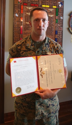 Capt. Peter Abramovs poses after being awarded the Air Medal during an awards ceremony at Marine Corps Air Station Cherry Point, N.C., July 28, 2017. Abramovs was awarded the Air Medal for helping his fellow Marines escape the flaming wreckage of their MV-22 Osprey on May 17, 2017. The aircraft experienced a hard landing during a training exercise at Marine Corps Training Area Bellows, O'ahu, Hawai'i. Abramovs is an AV-8B Harrier II pilot assigned to Marine Attack Squadron 231, Marine Aircraft Group 14, 2nd Marine Aircraft Wing. (U.S. Marine Corps Photo by Pfc. Skyler Pumphret/ Released)