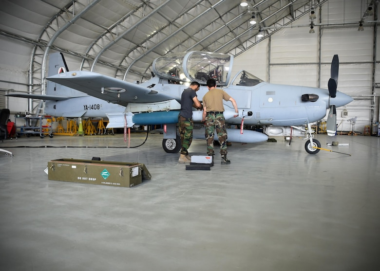 Two Afghan Air Force A-29 Super Tucano maintainers download GBU-12s (Guided Bomb Unit) at Kabul Air Wing, Afghanistan, July 26, 2017. Recently, AAF A-29 maintenance leadership requested to take full responsibility for flight line maintenance operations from Train, Advise, Assist Command-Air advisors and contract maintenance. This initiative by the maintainers is another step closer to the AAF becoming a professional, capable and sustainable force. (U.S. Air Force photo by Tech. Sgt. Veronica Pierce)