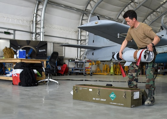 An Afghan Air Force A-29 Super Tucano maintainer downloads a GBU-12s (Guided Bomb Unit) at Kabul Air Wing, Afghanistan, July 26, 2017. Recently, AAF A-29 maintenance leadership requested to take full responsibility for flight line maintenance operations from Train, Advise, Assist Command-Air advisors and contract maintenance. This initiative by the maintainers is another step closer to the AAF becoming a professional, capable and sustainable force. (U.S. Air Force photo by Tech. Sgt. Veronica Pierce)