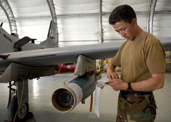 An Afghan Air Force A-29 Super Tucano maintainer reviews technical order instructions before downloading two GBU-12s (Guided Bomb Unit) at Kabul Air Wing, Afghanistan, July 26, 2017. Recently, AAF A-29 maintenance leadership requested to take full responsibility for flight line maintenance operations from Train, Advise, Assist Command-Air advisors and contract maintenance. This initiative by the maintainers is another step closer to the AAF becoming a professional, capable and sustainable force. (U.S. Air Force photo by Tech. Sgt. Veronica Pierce)