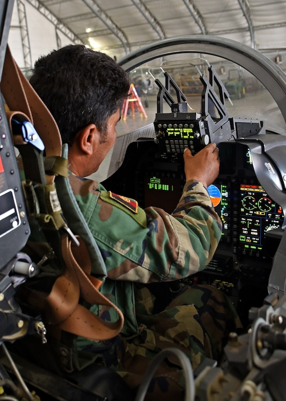 An Afghan Air Force A-29 Super Tucano maintainer performs an avionics check in the cockpit of the aircraft at Kabul Air Wing, Afghanistan, July 26, 2017. Recently, AAF A-29 maintenance leadership requested to take full responsibility for flight line maintenance operations from Train, Advise, Assist Command-Air advisors and contract maintenance. This initiative by the maintainers is another step closer to the AAF becoming a professional, capable and sustainable force. (U.S. Air Force photo by Tech. Sgt. Veronica Pierce)