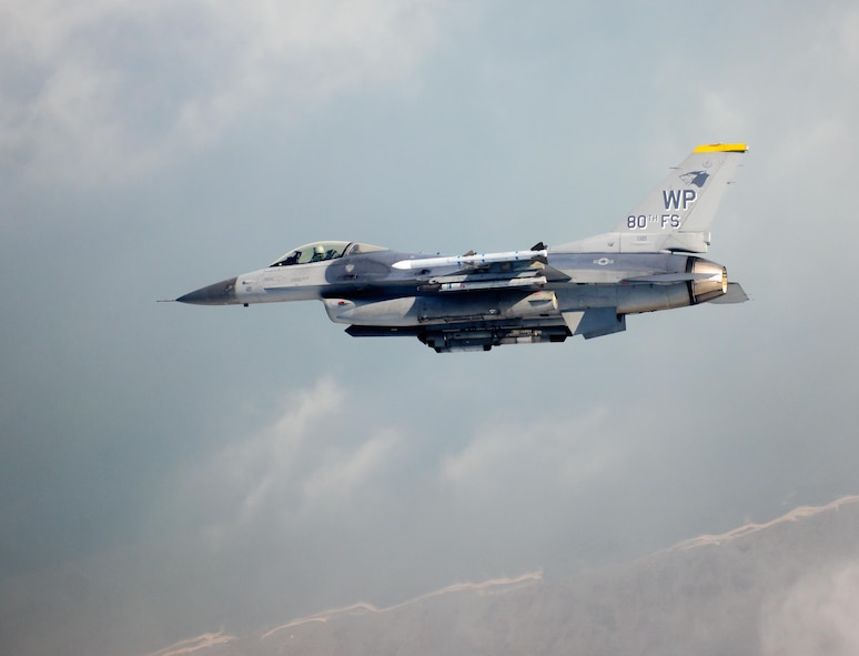 An 80th Fighter Squadron F-16 Fighting Falcon flies in the skies above Kunsan Air Base, South Korea. The 80th will take part in Red Flag Alaska over course of several days. (U.S. Air Force Photo/Senior Airman Armando A. Schwier-Morales)