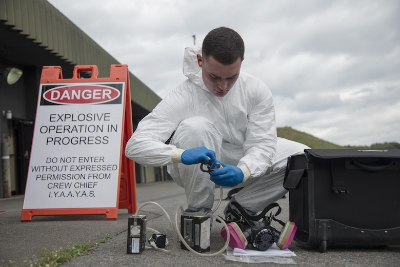 Senior Airman Petri Brand, a 35th Aerospace Medicine Squadron bioenvironmental engineer technician, prepares air quality testing equipment kit during a mandatory occupational health risk assessment of two Airmen sanding a precision guided munition at Misawa Air Base, Japan, May 11, 2017. Monthly water sampling and contingency operations are also among the duties Brand performs. (U.S. Air Force photo by Staff Sgt. Melanie A. Hutto)