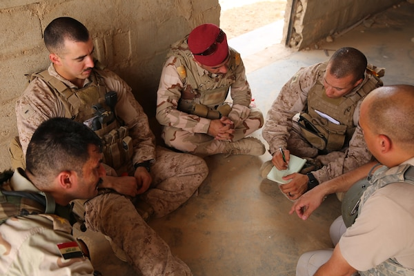 U.S. Marine Corps 1st Lt. Christian Castilla and Gunnery Sgt. Ryan Kirkham, the combined anti-armor team platoon commander and platoon sergeant attached to Task Force Al Asad with 1st Battalion, 7th Marine Regiment, Special Purpose Marine Air-Ground Task Force-Crisis Response-Central Command, conduct a de-brief with Iraqi officers of the 7th Iraqi Infantry Division at Al Asad Air Base, Iraq, July 7, 2017. These Marines are part of the Task Force's coalition security force team in charge of providing security to the base and personnel onboard. Task Force Al Asad's mission is to advise and assist and build partner capacity with the Iraqi Security Forces in Al Anbar province in support of Combined Joint Task Force-Operation Inherent Resolve, the global coalition to defeat ISIS in Iraq and Syria. (U.S. Marine Corps photo by 1st Lt. Dave Williams)