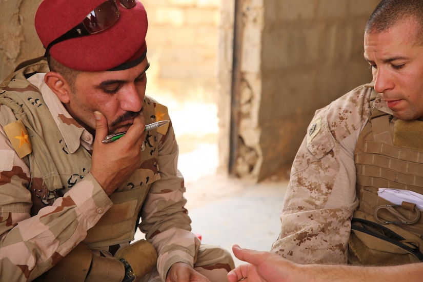 U.S. Marine Corps Gunnery Sgt. Ryan Kirkham, the combined anti-armor team platoon sergeant attached to Task Force Al Asad with 1st Battalion, 7th Marine Regiment, Special Purpose Marine Air-Ground Task Force-Crisis Response-Central Command, conducts a de-brief with Iraqi officer of the 7th Iraqi Infantry Division at Al Asad Air Base, Iraq, July 7, 2017. These Marines are part of the Task Force's coalition security force team in charge of providing security to the base and personnel onboard. Task Force Al Asad's mission is to advise and assist and build partner capacity with the Iraqi Security Forces in Al Anbar province in support of Combined Joint Task Force-Operation Inherent Resolve, the global coalition to defeat ISIS in Iraq and Syria. (U.S. Marine Corps photo by 1st Lt. Dave Williams)