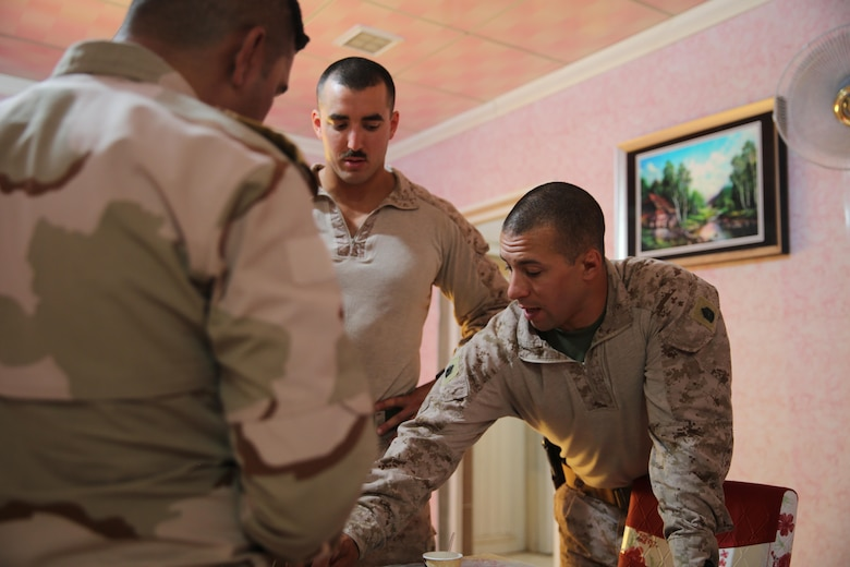 U.S. Marine Corps 1st Lt. Christian Castilla and Gunnery Sgt. Ryan Kirkham, the combined anti-armor team platoon commander and platoon sergeant attached to Task Force Al Asad from 1st Battalion, 7th Marine Regiment, Special Purpose Marine Air-Ground Task Force-Crisis Response-Central Command, discuss infantry tactics with an Iraqi officer of the 7th Iraqi Infantry Division during training at Al Asad Air Base, Iraq, July 7, 2017. These Marines are part of the Task Force's coalition security force team in charge of providing security to the base and personnel onboard. Task Force Al Asad's mission is to advise and assist and build partner capacity with  the Iraqi Security Forces in Al Anbar province in support of Combined Joint Task Force-Operation Inherent Resolve, the global coalition to defeat ISIS in Iraq and Syria. (U.S. Marine Corps photo by 1st Lt. Dave Williams)