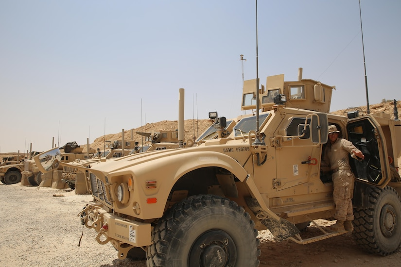 U.S. Marine Corps Lance Cpl. Johnny Perez, a mortarman assigned to Task Force Al Asad, with 1st Battalion, 7th Marines, Special Purpose Marine Air-Ground Task Force-Crisis Response-Central Command, loads gear into a mine-resistant, ambush-protected all-terrain vehiclewhile at Al Asad Air Base, Iraq, July 5, 2017. These Marines are part of the Task Force's coalition security force team in charge of providing security to the base and personnel onboard. Task Force Al Asad's mission is to advise and assist and build partner capacity with the Iraqi Security Forces in Al Anbar province in support of Combined Joint Task Force-Operation Inherent Resolve, the global coalition to defeat ISIS in Iraq and Syria. (U.S. Marine Corps photo by 1st Lt. Dave Williams)