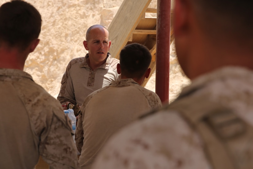 U.S. Marine Corps Gunnery Sgt. Tracy Cazee, security force detachment operations chief attached to Task Force Al Asad with 1st Battalion, 7th Marine Regiment, from Special Purpose Marine Air-Ground Task Force-Crisis Response-Central Command, briefs his Marines prior to assuming their security positions while at Al Asad Air Base, Iraq, July 5, 2017. These Marines are part of the Task Force's coalition security force team in charge of providing security to the base and personnel onboard. Task Force Al Asad's mission is to advise and assist  and build partner capacity with the Iraqi Security Forces in Al Anbar province in support of Combined Joint Task Force-Operation Inherent Resolve, the global coalition to defeat ISIS in Iraq and Syria. (U.S. Marine Corps photo by 1st Lt. Dave Williams)