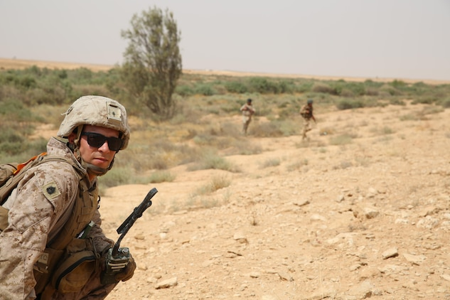 U.S. Marine Corps Gunnery Sgt. Ryan Kirkham, the combined anti-armor team platoon sergeant attached to Task Force Al Asad with 1st Battalion, 7th Marine Regiment, Special Purpose Marine Air-Ground Task Force-Crisis Response-Central Command, observes soldiers of the 7th Iraqi Infantry Division during training at Al Asad Air Base, Iraq, July 7, 2017. These Marines are part of the Task Force's coalition security force team in charge of providing security to the base and personnel onboard. Task Force Al Asad's mission is to advise and assist and build partner capacity with  the Iraqi Security Forces in Al Anbar province in support of Combined Joint Task Force-Operation Inherent Resolve, the global coalition to defeat ISIS in Iraq and Syria. (U.S. Marine Corps photo by 1st Lt. Dave Williams)