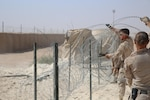 U.S. Marine Corps Cpl. Bridget Bastian and Lance Cpl. Jonathan Fer, both combat engineers attached to Task Force Al Asad with Marine Wing Support Squadron (MWSS) 372 ,Special Purpose Marine Air-Ground Task Force-Crisis Response-Central Command, improve force protection measures by laying concertina wire at Al Asad Air Base, Iraq, July 6, 2017. The Marines of the Engineering Detachment work daily on a variety of engineer tasks in support of the master base plan for Task Force Al Asad. Task Force Al Asad's mission is to advise and assist  and build partner capacity with the Iraqi Security Forces in Al Anbar province in support of Combined Joint Task Force-Operation Inherent Resolve, the global coalition to defeat ISIS in Iraq and Syria. (U.S. Marine Corps photo by 1st Lt. Dave Williams)