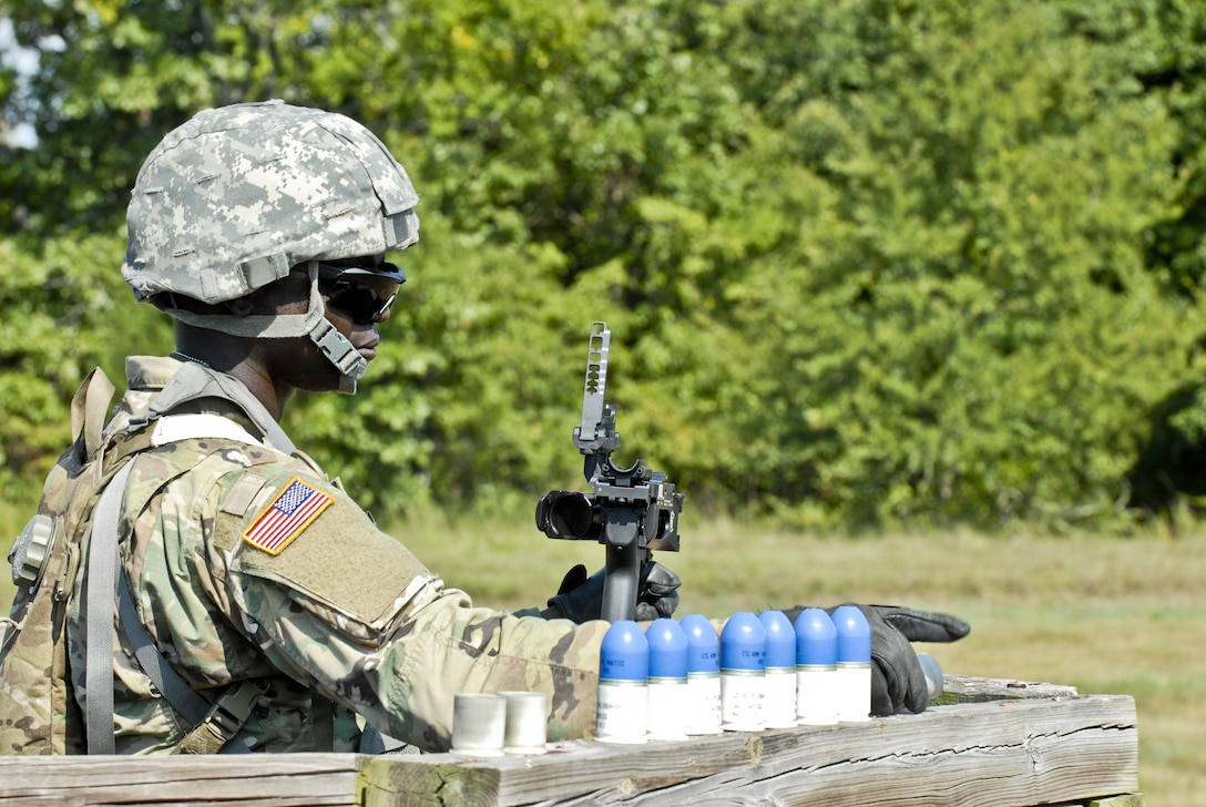 Spc. Ibukunoluwa Korede, a U.S. Army Reserve wheeled vehicle mechanic and electrical engineering student with the 844th HHC, Engineer Battalion, 411th Engineer Brigade, 412th Theater Engineer Command, prepares to load and familiarize fire the new M320 40mm grenade launcher during River Assault 2017 at Fort Chaffee Maneuver Center, Ark., July 24, 2017. River Assault 2017 is a two-week extended combat training exercise held July 15-28 focusing on technical skills, of various service members, culminating with the construction of a floating improved ribbon bridge across the Arkansas River.  (U.S. Army Reserve Photo by Staff Sgt. Roger Ashley)