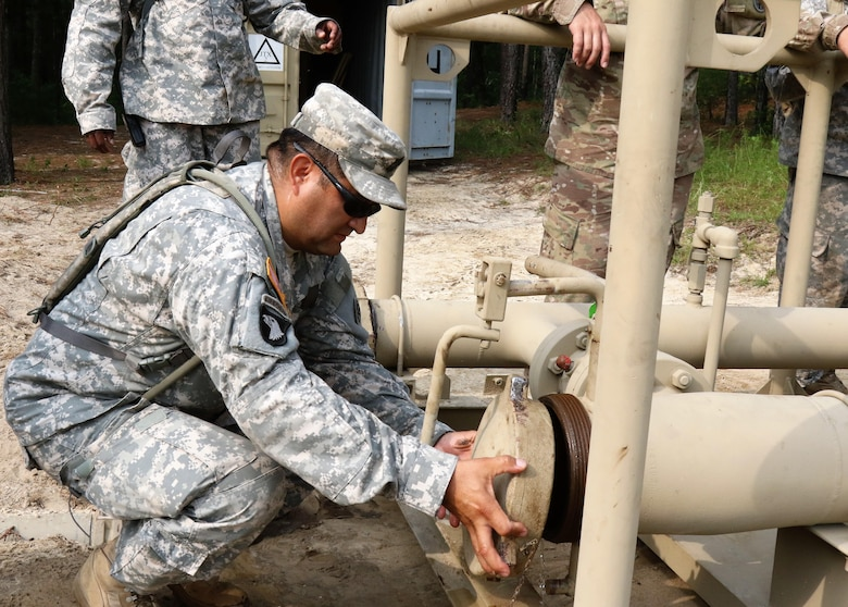U.S. Army Reserve Master Sgt. Hector Guerrero, senior detachment sergeant with the 809th Quartermaster Liaison Detachment, inspects petroleum equipment during the two-week 2017 Quartermaster Liquid Logistics Exercise in Ft. Bragg, NC, Jul. 14 to 27, 2017.  QLLEX allows U.S. Army Reserve units to demonstrate their skills and provide real-world fuel and water support while training at the tactical, operational, and strategic level.  (U.S. Army Reserve Photo by Maj. Brandon R. Mace)