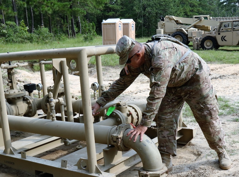 U.S. Army Reserve Sgt. 1st Class Pato Mareko, a requirements NCO with the 809th Quartermaster Liaison Detachment, inspects petroleum equipment during the two-week 2017 Quartermaster Liquid Logistics Exercise in Ft. Bragg, NC, Jul. 14 to 27, 2017.  QLLEX allows U.S. Army Reserve units to demonstrate their skills and provide real-world fuel and water support while training at the tactical, operational, and strategic level.  (U.S. Army Reserve Photo by Maj. Brandon R. Mace)