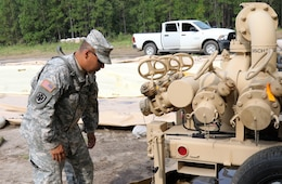 U.S. Army Reserve Chief Warrant Officer 2 Ronald Hinshaw, a Petroleum Systems Technician with the 809th Quartermaster Liaison Detachment, inspects petroleum equipment during the two-week 2017 Quartermaster Liquid Logistics Exercise in Ft. Bragg, NC, Jul. 14 to 27, 2017.  QLLEX allows U.S. Army Reserve units to demonstrate their skills and provide real-world fuel and water support while training at the tactical, operational, and strategic level.  (U.S. Army Reserve Photo by Maj. Brandon R. Mace)
