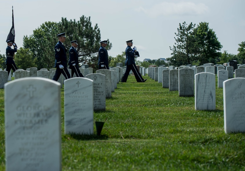 Air Force Ceremonial Guardsmen escort the remains of retired Col. Bruce Olmstead during his funeral at Arlington National Cemetery, Arlington, Va., July 27, 2017. Olmstead served from 1957 to 1983, receiving multiple decorations including Silver Star, Distinguished Flying Cross and Purple Heart for his actions as a prisoner of war. (U.S. Air Force photo by Senior Airman Rusty Frank/Released)