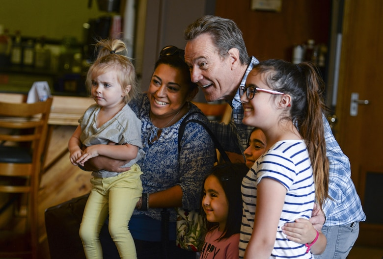 Actor Bryan Cranston takes a photo with members of Team Mildenhall July 29, 2017, during a United Service Organization Tour on RAF Mildenhall, England. Cranston started the tour off by visiting with Airmen and their families at the Bob Hope Community Center. (U.S. Air Force photo by Staff Sgt. Micaiah Anthony)