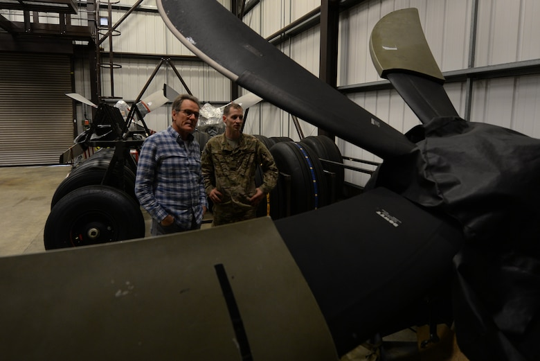 A U.S. Air Commando from the 352nd Special Operations Aircraft Maintenance Squadron gives actor Bryan Cranston a tour of the decentralized material support section July 29, 2017, during a United Service Organization Tour on RAF Mildenhall, England. After visiting Airmen and their families at the Bob Hope Community Center, Cranston toured the base, dined with Airmen and made a visit to the 352nd SOMXG. (U.S. Air Force photo by Staff Sgt. Micaiah Anthony)