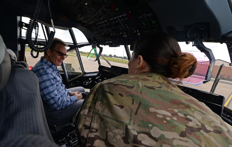 A U.S. Air Commando from the 352nd Special Operations Maintenance Group briefs actor Bryan Cranston, about the avionics systems of an MC-130 J Command II, July 29, 2017, during a United Service Organization Tour on RAF Mildenhall, England. Cranston toured the base to learn about Team Mildenhall's mission and boost morale for Airmen and their families. (U.S. Air Force photo by Staff Sgt. Micaiah Anthony)