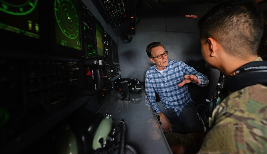 A U.S. Air Commando from the 352nd Special Operations Maintenance Group explains how the camera on an MC-130J Commando II works to actor Bryan Cranston, July 29, 2017, during a United Service Organization Tour on RAF Mildenhall, England. Cranston toured the base to learn about Team Mildenhall's mission and boost morale for Airmen and their families. (U.S. Air Force photo by Staff Sgt. Micaiah Anthony)