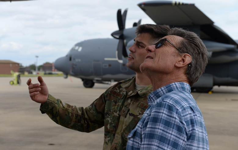 A U.S. Air Commando from the 352nd Special Operations Maintenance Group gives actor Bryan Cranston a tour of an MC-130 J Command II, July 29, 2017, during a United Service Organization Tour on RAF Mildenhall, England. Cranston is an award-winning actor known for his roles in popular television shows 'Breaking Bad' and 'Malcom in the Middle,' along with movies such as 'Godzilla' (2014) and 'Trumbo'. (U.S. Air Force photo by Staff Sgt. Micaiah Anthony)