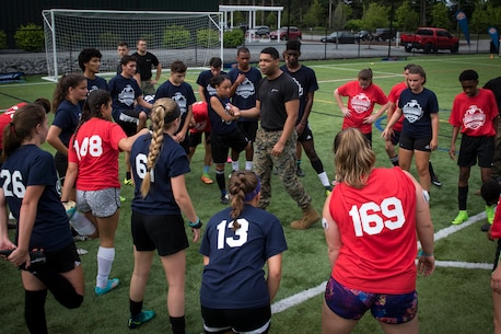 Staff Sgt. Andre Diaz gives a talk about individual and team endurance to participants of the Sports Leadership Academy - Boston Soccer program at the Fore Kicks facility in Taunton, Mass., July 22, 2017. The academy is a free program offered to high school athletes to boost their soccer skills and gain leadership knowledge from the local Marine recruiters. Diaz is a canvassing recruiter with Recruiting Substation Brockton, Mass.