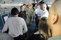 """U.S. Strategic Command (USSTRATCOM) """"Experience Day"""" participants learn about the OC-135B Open Skies observation aircraft at Offutt Air Force Base, Neb., on July 28, 2017.  International, military, governmental, academic and industry experts who attended the 2017 USSTRATCOM Deterrence Symposium were invited to the half-day event. More than 50 individuals were given a USSTRATCOM mission brief, toured the Global Operations Center and visited a B-52 Stratofortress, E-6B Mercury and a Terminal High Altitude Area Defense launcher."""