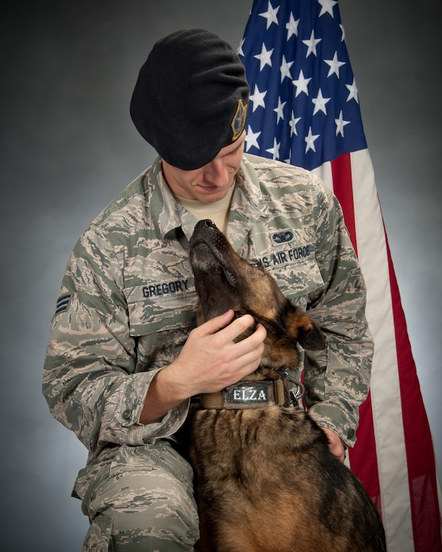 Senior Airman Clinton Gregory, 42nd Security Forces Squadron military working dog handler, with his MWD Elza at Maxwell Air Force Base, Ala. Gregory said this photo illustrates Elza's playful nature and the bond the two had formed while working together. Elza succumbed to cancer in early July 2017 months before she was set to retire. (Courtesy photo)
