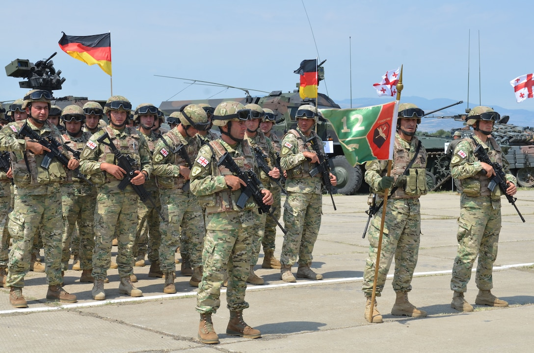 Georgian troops wait in formation during rehearsals for the opening ceremonies of exercise Noble Partner at Vaziani Military Base, Georgia, July 30, 2017. Noble Partner is a multinational, U.S. Army Europe-led exercise conducting home station training for the Georgian light infantry company designated for the NATO Response Force. Army photo by Sgt. Shiloh Capers