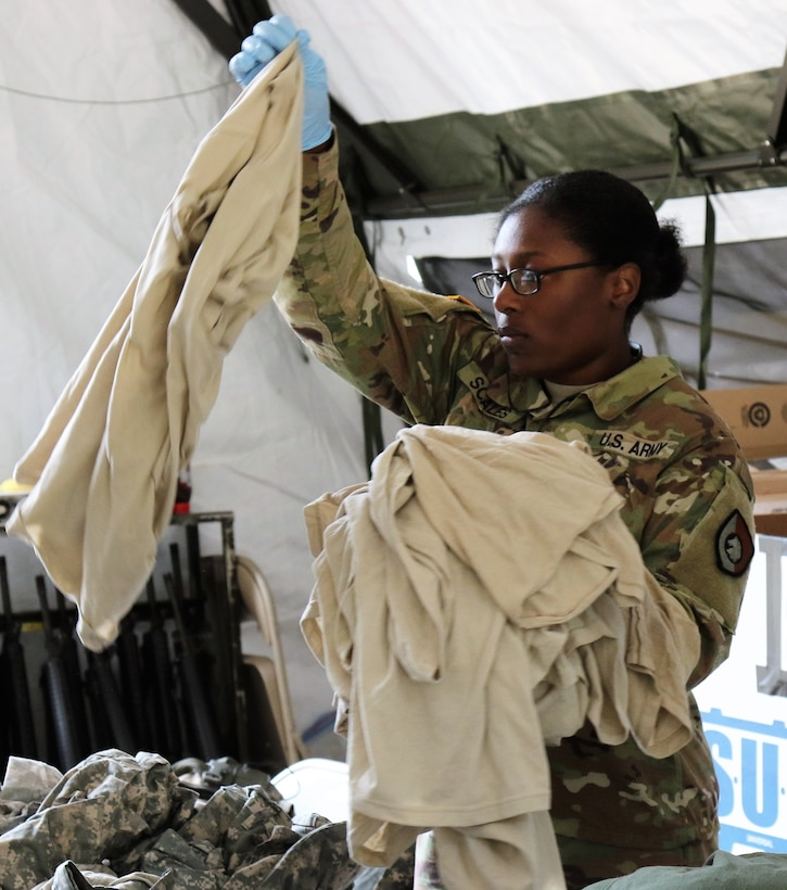 U.S. Army Reserve Pvt. 1st Class Sondra Scales, a utilities equipment repairer with the 340th Quartermaster Company, sorts laundry during the two-week 2017 Quartermaster Liquid Logistics Exercise at Joint Base Lewis McChord, WA, Jul. 14 to 27, 2017.  QLLEX allows U.S. Army Reserve units to demonstrate their skills and provide real-world fuel and water support while training at the tactical, operational, and strategic level.  (U.S. Army Reserve Photo by Maj. Brandon R. Mace)