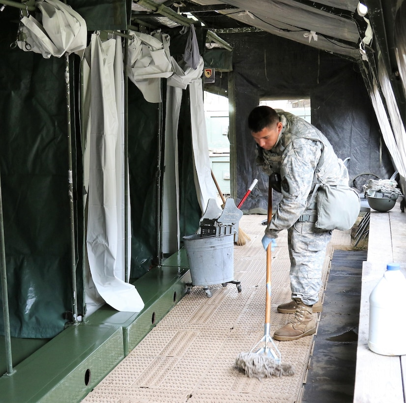U.S. Army Reserve Spc. Domingo Mata, a shower/laundry and clothing repair specialist with the 340th Quartermaster Company, mops a shower floor during the two-week 2017 Quartermaster Liquid Logistics Exercise at Joint Base Lewis McChord, WA, Jul. 14 to 27, 2017.  QLLEX allows U.S. Army Reserve units to demonstrate their skills and provide real-world fuel and water support while training at the tactical, operational, and strategic level.  (U.S. Army Reserve Photo by Maj. Brandon R. Mace)