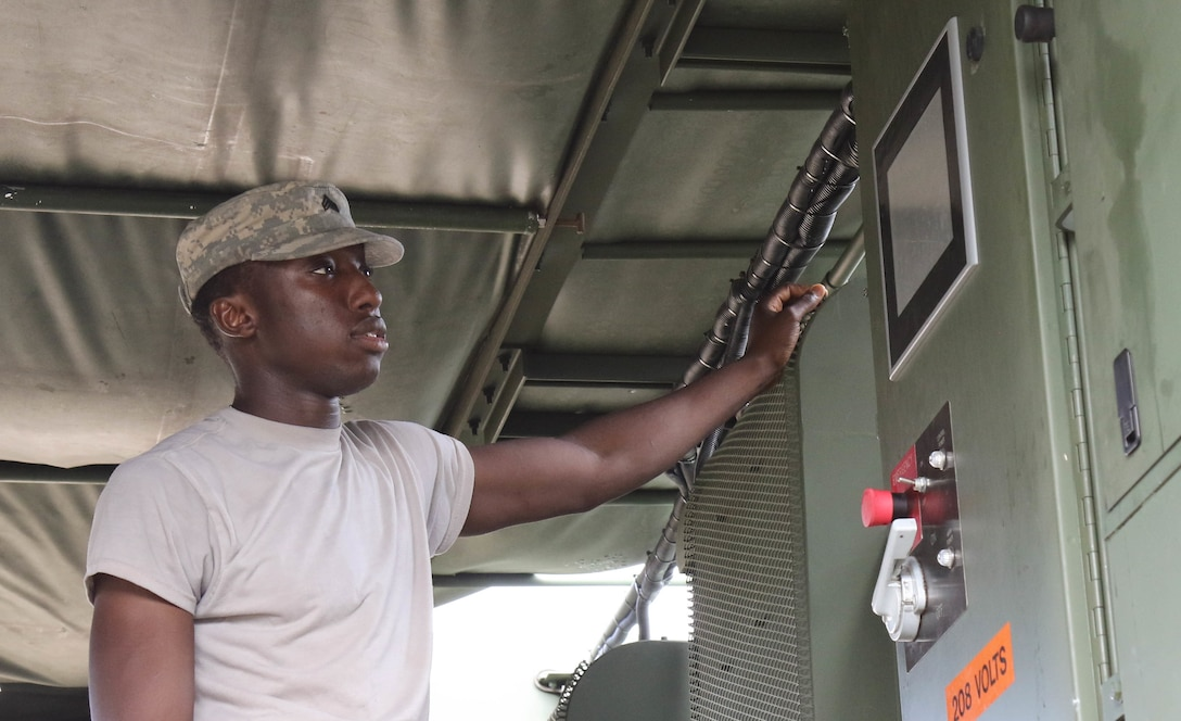U.S. Army Reserve Sgt. Michael Jatta, a shower/laundry and clothing repair specialist with the 242nd Quartermaster Company, maintains a Laundry Advanced System during the two-week 2017 Quartermaster Liquid Logistics Exercise at Fort Stewart, GA, Jul. 14 to 27, 2017.  QLLEX allows U.S. Army Reserve units to demonstrate their skills and provide real-world fuel and water support while training at the tactical, operational, and strategic level.  (U.S. Army Reserve Photo by Maj. Brandon R. Mace)